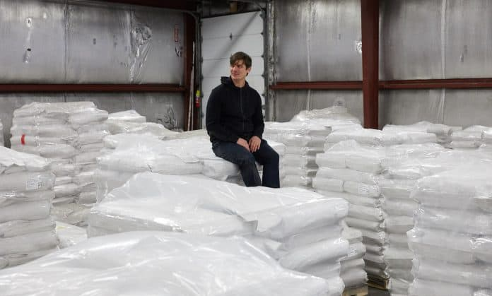 CEO and Founder of Eat Just Josh Tetrick sits on bags of plant protein, photo: Eat Just, Inc. / Reuters