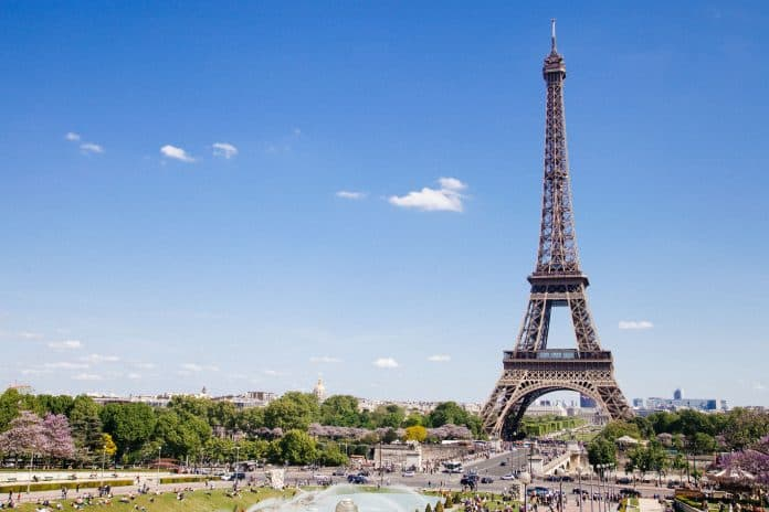 Eiffel Tower in Paris on a beautiful sunny day with clear blue sky