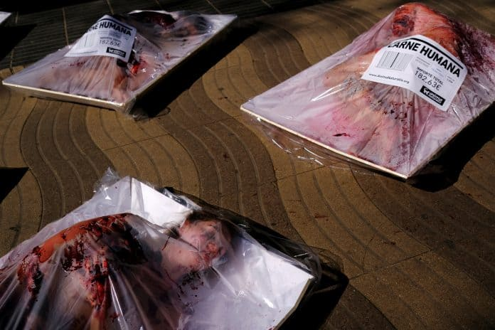 Humans covered in blood on white trays sold as meat, photo: Reuters/Nacho Doce