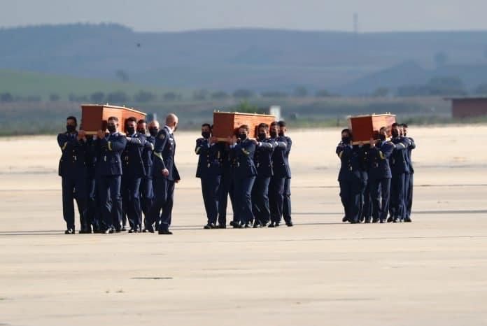 Spanish Air Force carry coffins of the three people killed during an anti-poaching patrol in Burkina Faso, Spain, April 30, 2021, credit: Reuters/Sergio Perez
